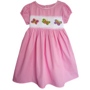 Pink smocked dress with colorful butterflies