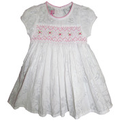 White smocked dress with red rose